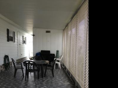 Carport with seating and gas grill