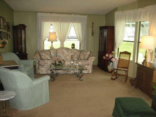 Senior retirement living 1986 palm harbor mobile home for Living room of satoshi tax