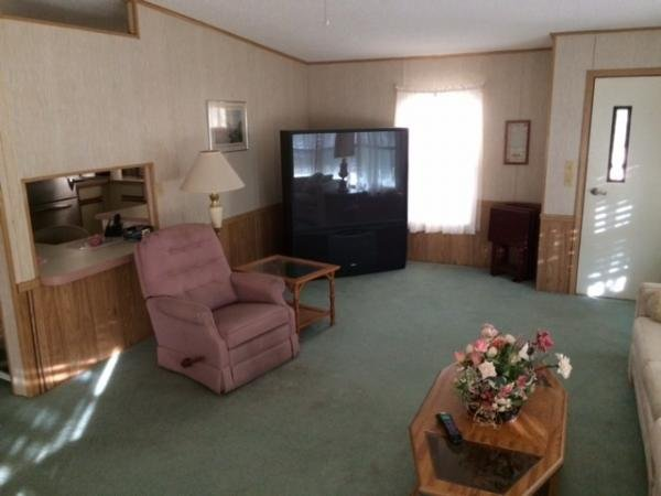 Senior retirement living 1987 homes of merit hs for Living room of satoshi tax