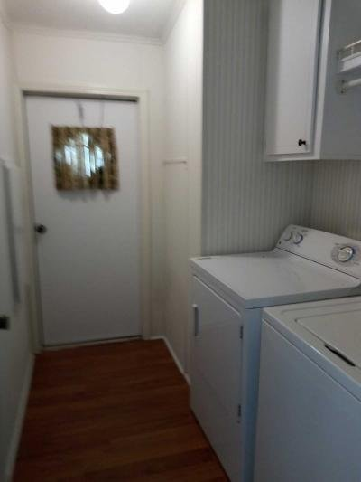 Laundry room with outside door