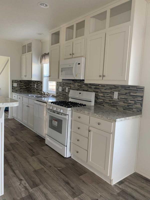 Upgraded white cabinets and glass backsplash