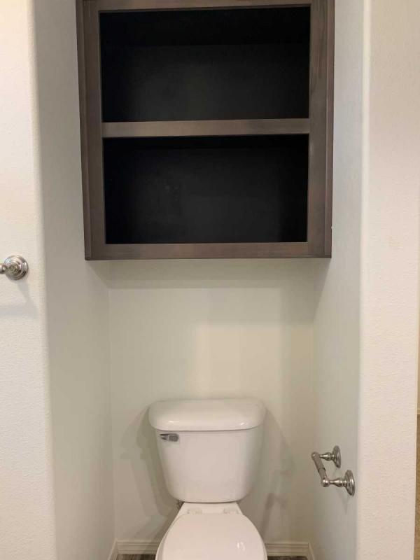 Additional over toilet storage