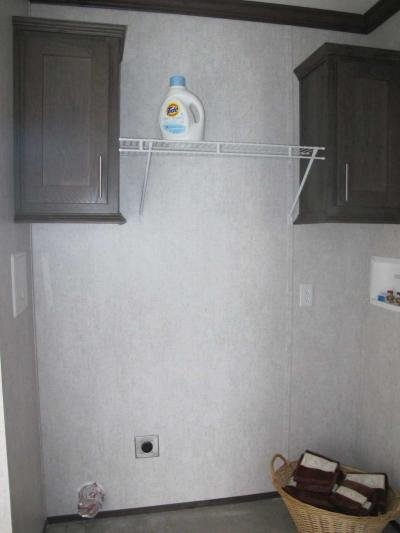 LAUNDRY AREA WITH CABINETRY