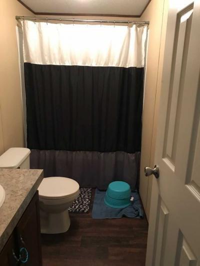 2nd bath near rear bedrooms