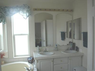 All white double sink Master bath
