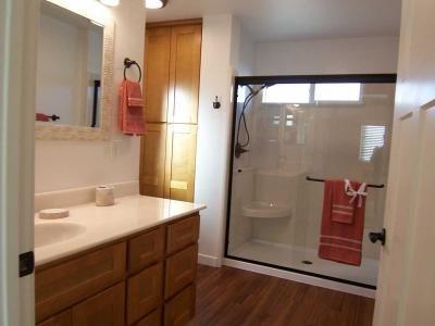 bath w/seat in double-wide shower.