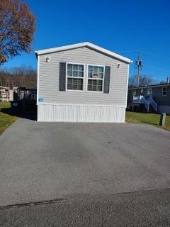 Front of home with paved driveway