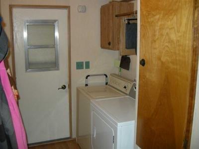 laundry area, carport exit