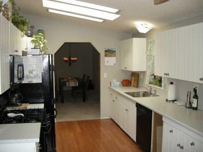 bright galley style kitchen
