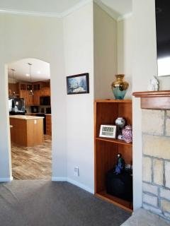 Arched doorways to kitchen.