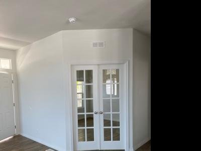French doors to den off living roo