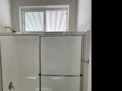 Window over tub shower in Guest Ba
