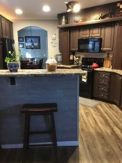 Looking at kitchen and dining area