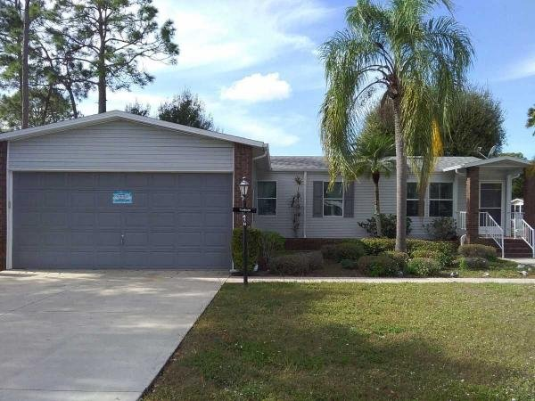 Photo 1 of 2 of home located at 10640 Lake Loop Rd. North Fort Myers, FL 33903