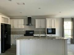 Photo 4 of 20 of home located at 13210 Orange Avenue Grand Island, FL 32735
