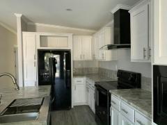 Photo 5 of 20 of home located at 13210 Orange Avenue Grand Island, FL 32735