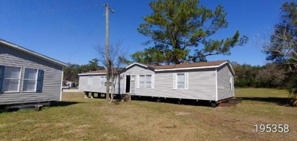 Photo 1 of 2 of home located at 4835 South Pine Ave. Ocala, FL 34480