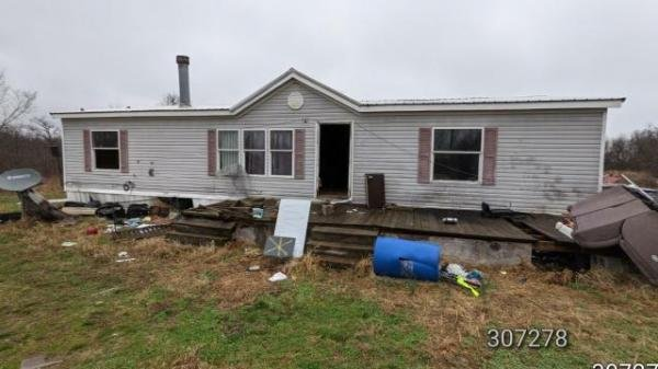 Photo 1 of 2 of home located at 10803 Providence Ln Granby, MO 64844
